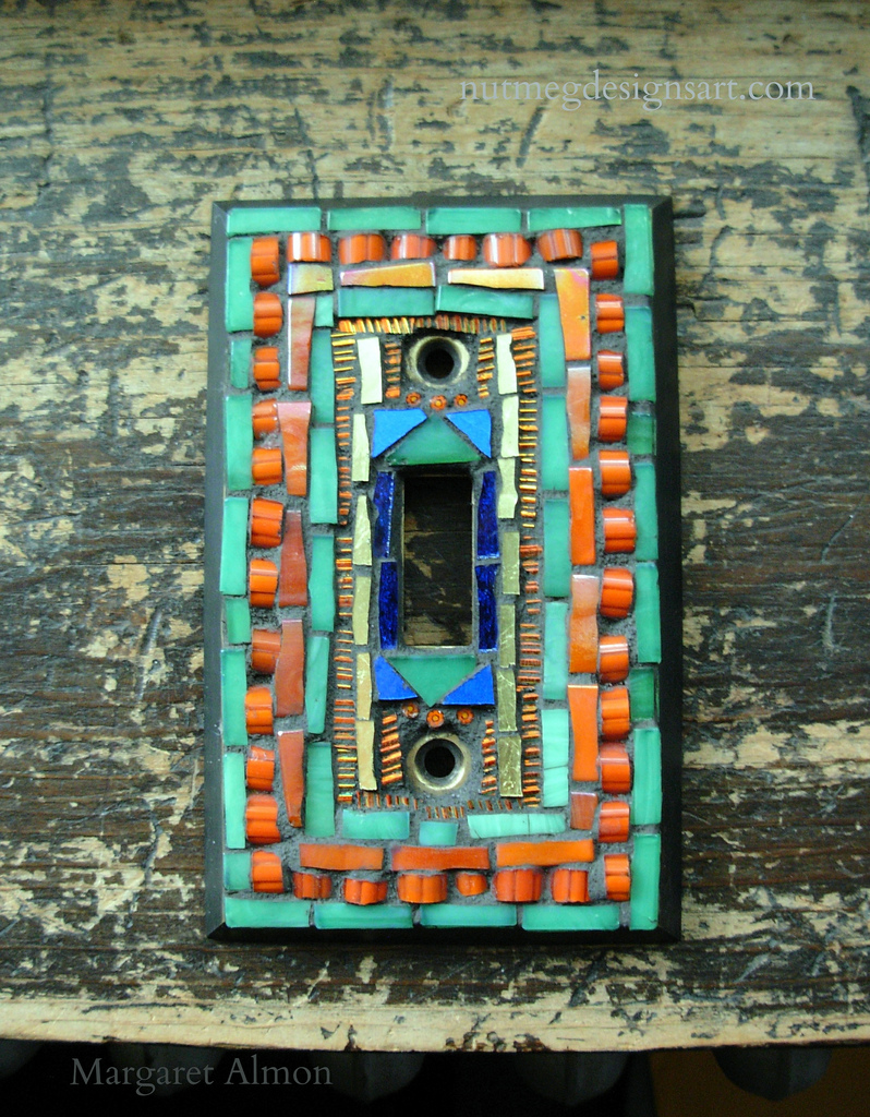 Mosaic Switchplate in Green, Orange and Gold, by Margaret Almon.