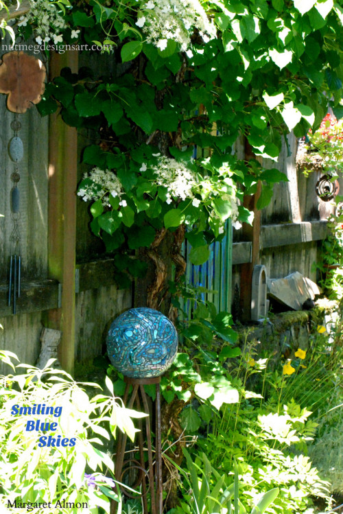 Smiling Blue Skies Mosaic Garden Ball by Margaret Almon