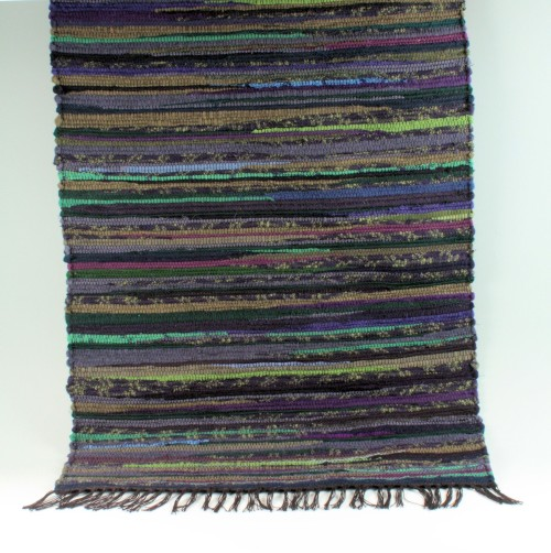 Traditional wool rag rug by Amy Turner.