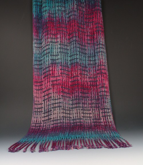 Rayon shawl woven in lace weave with hand dyed yarns by Amy Turner.