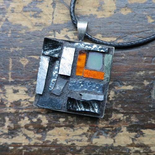 Gray Pendant with a Flash of Orange by Margaret Almon.