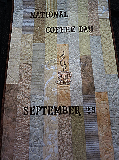 National Coffee Day Quilt by Bonnie Dwyer at the Pennsylvania Quilt Extravaganza, 2014. Photo by Wayne Stratz.