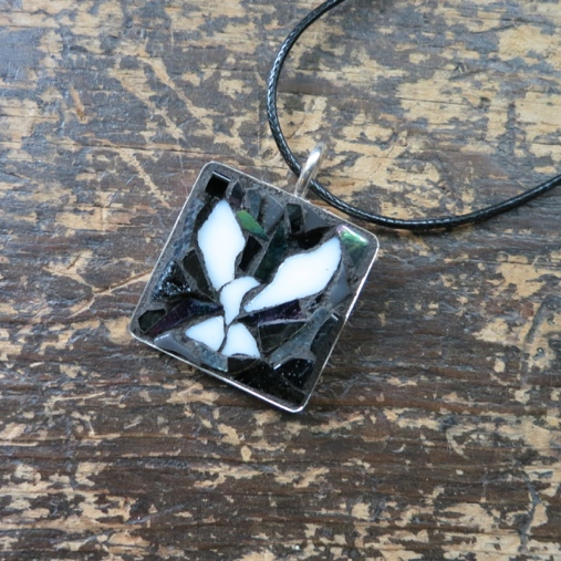 Film Noir Dove Pendant by Nutmeg Designs. Dove created by a Wayne Stratz and background mosaic by Margaret Almon.