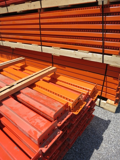Orange Shelving Waiting to Be Installed at Warner Glass