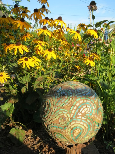Black-eyed Susans in the Garden of Nutmeg Designs with Margaret's Mosaic Bowling Ball