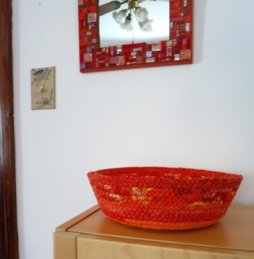 Basket by Margaret DeCook. Mosaic Mirror by Margaret Almon.