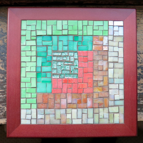 Asymmetric Log Cabin Trivet in Moss, Coral and Sand by Margaret Almon. Glass on wood, 8 inches.