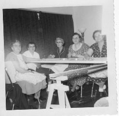 Helen Danner and her Quilting Group. (2nd from the right)